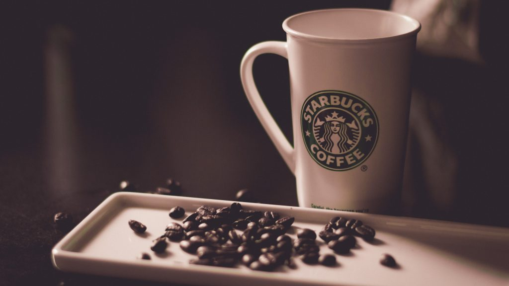 Starbucks coffee mug and beans